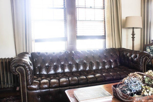 Brown Leather Couch and Linen Curtains