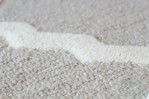 White and Tan detailing on wool rug