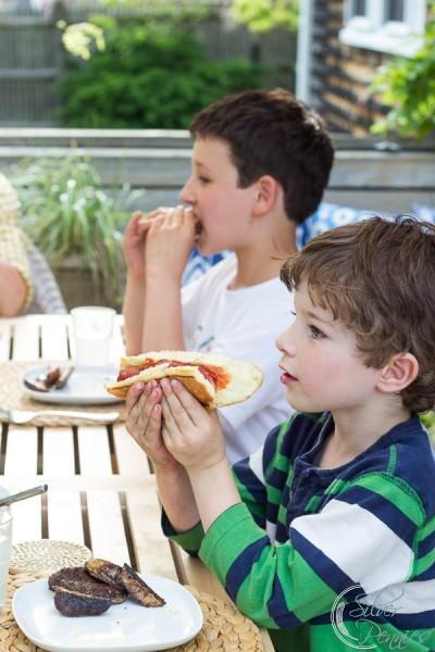 Boys eating burgers
