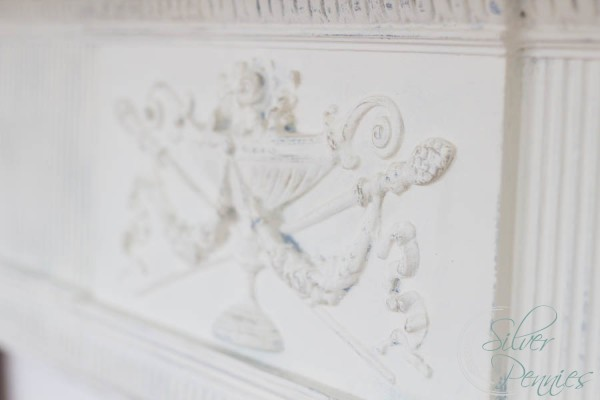 Detailing on vintage mantel