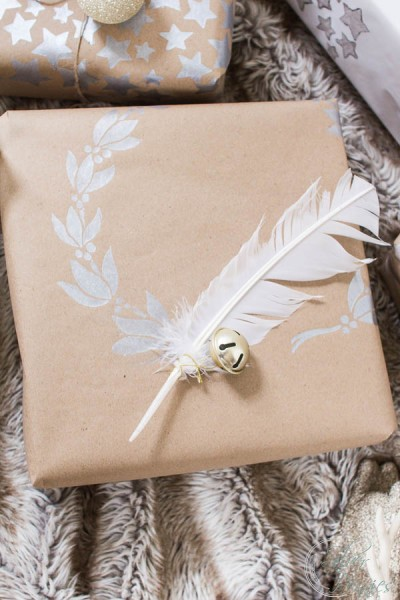 Simple feather and holly stencil on a package
