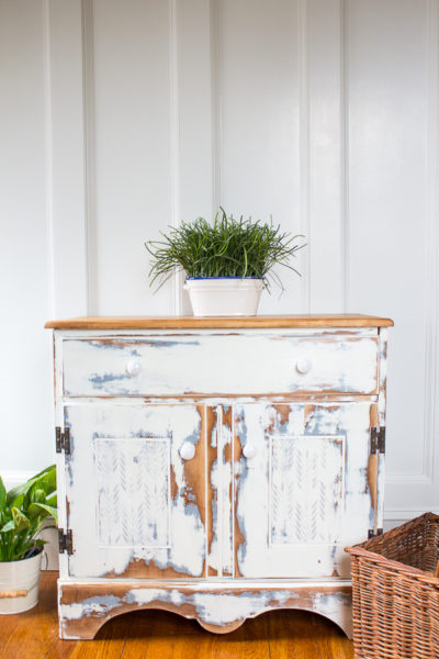 Heavily Distressed White Cabinet - how to get that farmhouse look.