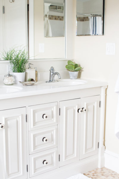 How to Paint a Vanity / By painting this once gold and dated vanity, Danielle has made this bathroom feel larger and clean. Easy step by step on how to paint your own vanity. www.findingsilverpennies.com