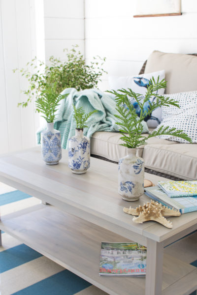 How to use an outdoor rug to make for an intimate coastal inspired space.