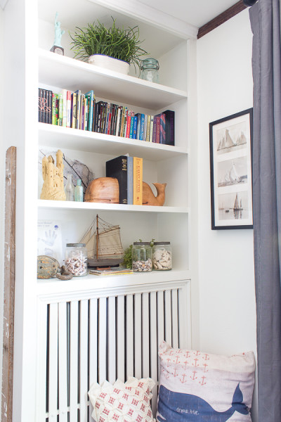 Coastal Storage and Bookshelves in Boys' Bedroom Makeover www.findingsilverpennies.com