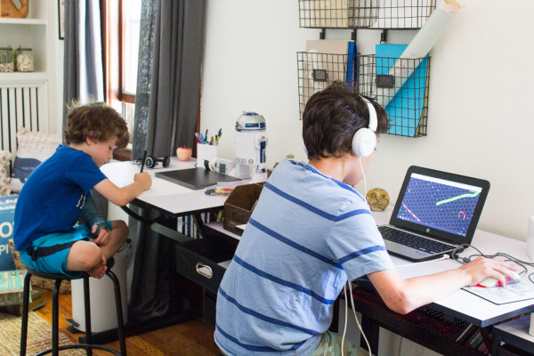 John and Conor enjoying their new work area in their bedroom.