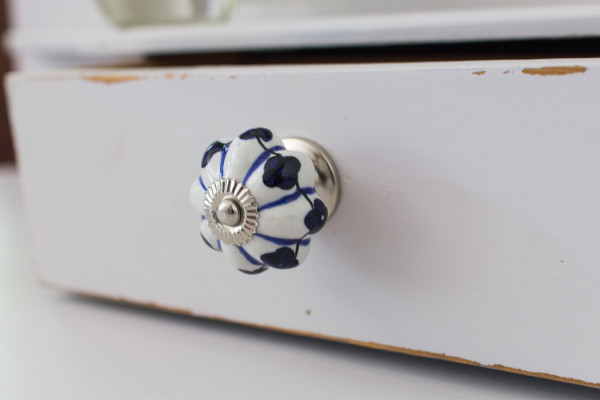 Beautiful ceramic knob against a soft painted piece with light distressing.