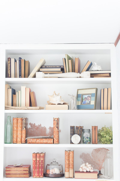 How to style bookshelves on a budget, some shells and sea glass make this perfect to transition to summer.