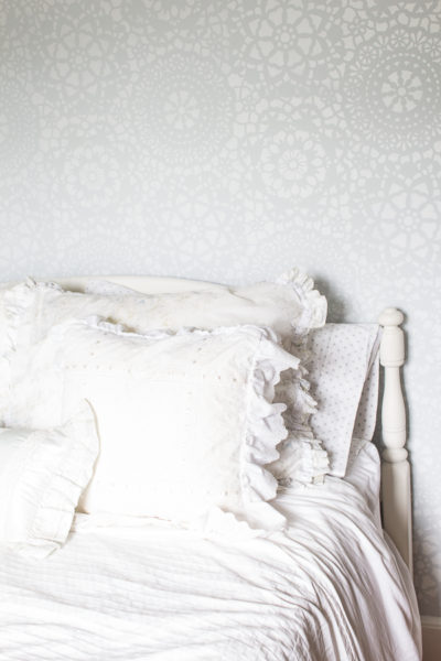 Our summer guest room, lovely linens and soft stenciled wall make this space inviting for guests.