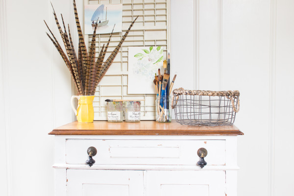 Pretty white farmhouse cabinet with naturally distressing full tutorial on Finding Silver Pennies.