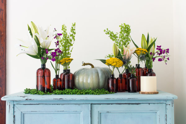Pretty amber bottles make the perfect vases / www.findingsilverpennies.com