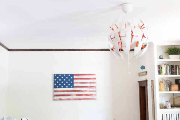 DIY American Flag and modern pendant light from Ikea. A winning combination for a child's bedroom! www.findingsilverpennies.com