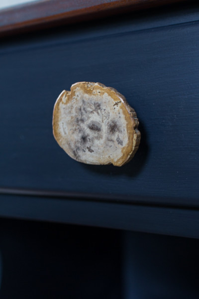 Petrified wood pull on coastal nightstand by Finding Silver Pennies