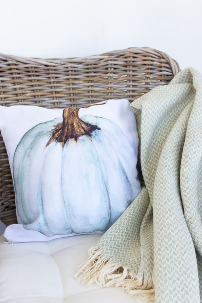 A pretty watercolor pillow by Craftberry Bush brightens up our sunroom for fall. www.findingsilverpennies.com