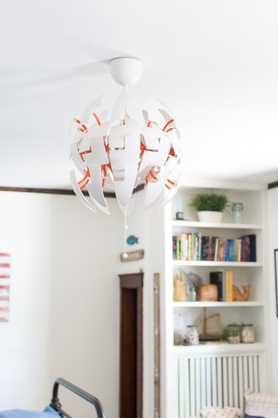 Amazing modern light brightens up this kids' bedroom and adds a grown up touch. www.findingsilverpennies.com
