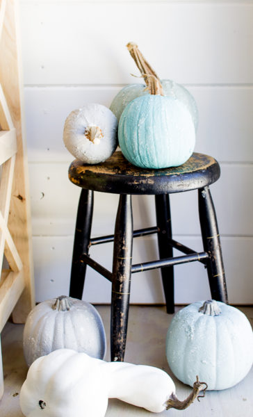 Saltwash pumpkins with a chippy black stool. Perfect fall decorating!