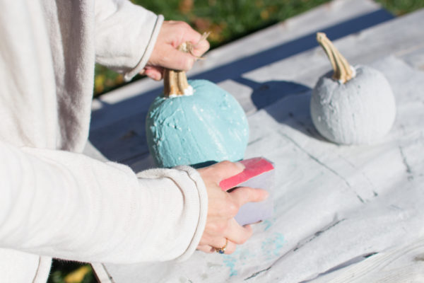 Sanding Pumpkins to show the under layer of Saltwash.