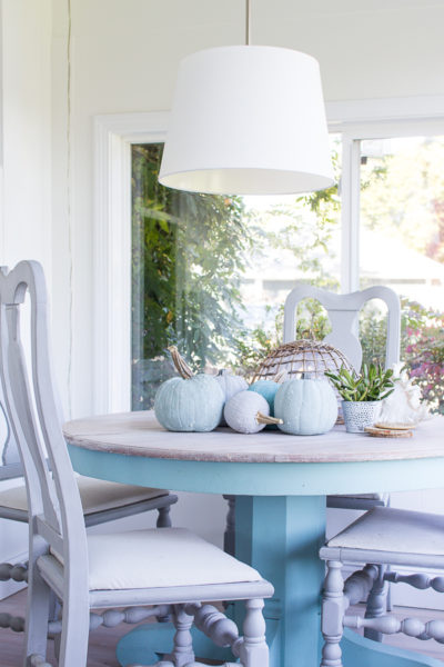 Textured pumpkins in cool colors add a hint of the coast to our fall sunroom.