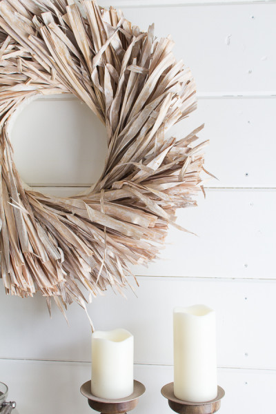 Grass wreath and warm candles against classic shiplap. The perfect way to celebrate fall on the coast. I Finding Silver Pennies I www.findingsilverpennies.com