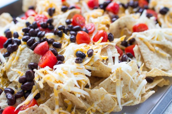 Making three cheese nachos with black beans