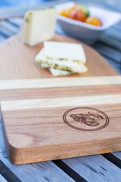 Pretty lobster chopping board and sliced cheese
