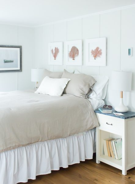 Simple sea fans, linen sheets and modern lights give this bedroom a classic yet modern feel