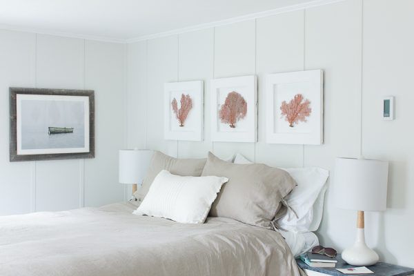 Soft and serene, warm neutrals make this seaside bedroom a happy place