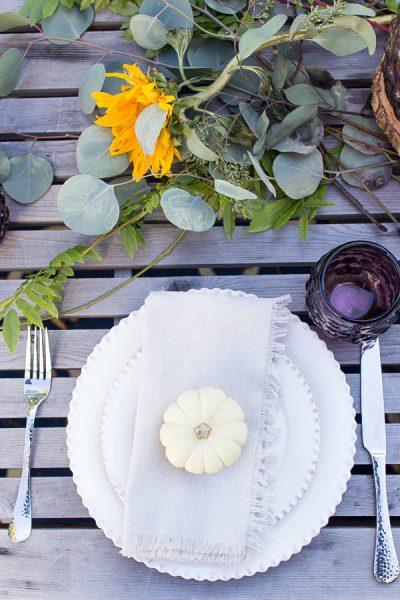 Simple Outdoor Tablescape to Celebrate Fall - mini pumpkins, eucalyptus, linen