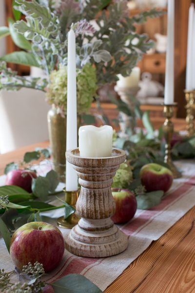 apples, candles and fresh greenery