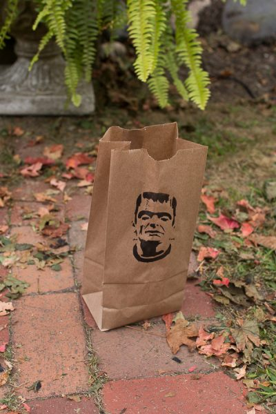 Simple lunch bags with a stencil become lanterns or treat bags for Halloween