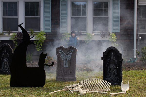 LED gravestones, a witch and bones add a creepy effect to our front lawn for Halloween