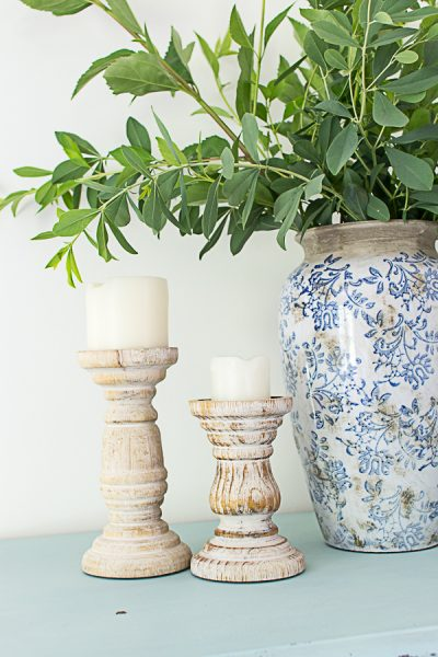 Simple branches and wooden candlesticks