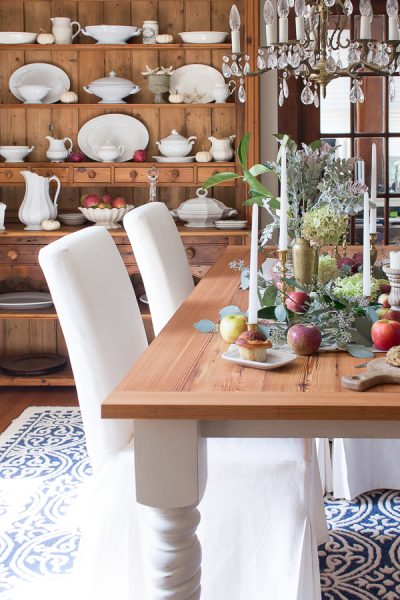 English style dining room with Ikea chairs and a DIY farmhouse table