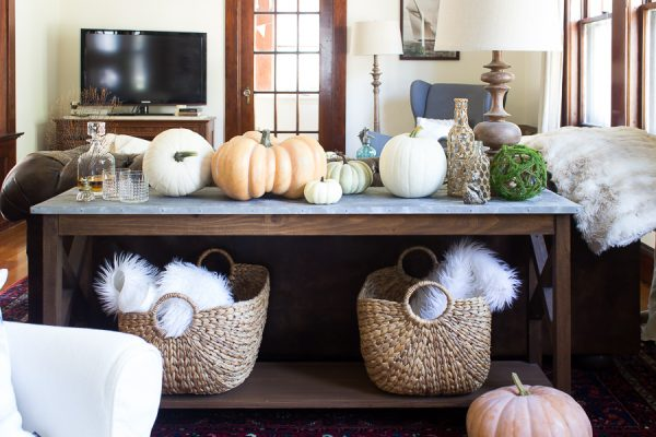 A faux galavanized table is pretty with pumpkins for fall