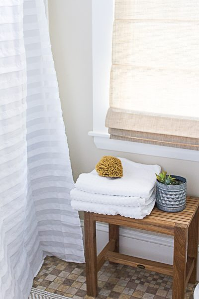 Seaside bathroom with teak, succulents and fluffy towels I Finding Silver Pennies