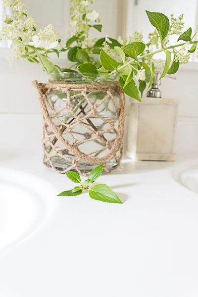 Fresh flowers in a glass vessel are pretty and refreshing in a bathroom I Finding Silver Pennies