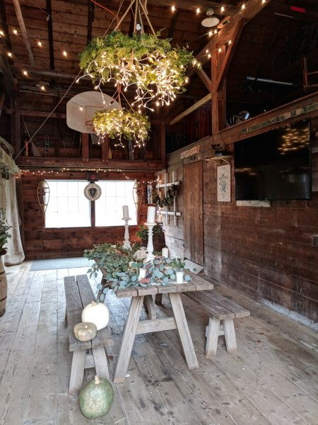 Entertaining in a barn - twinkling lights and fresh eucalyptus