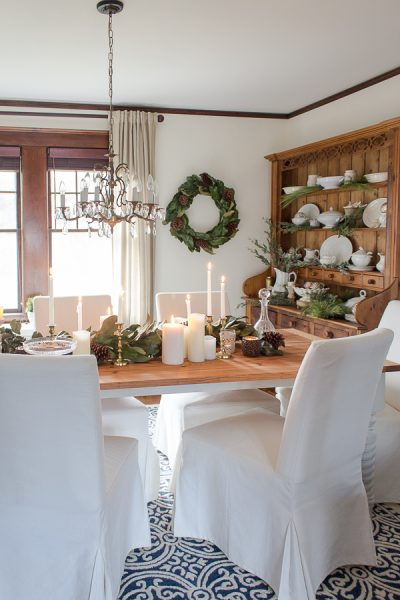 Christmas in the Dining Room - slipcovered chairs, farmhouse table and white candle light I Finding Silver Pennies
