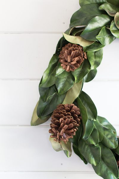 Festive magnolia and pinecone wreath I Finding Silver Pennies