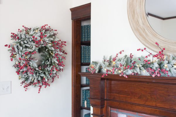 Dark Woodwork and Pretty lit Christmas Wreath and Garland I Finding Silver Pennies