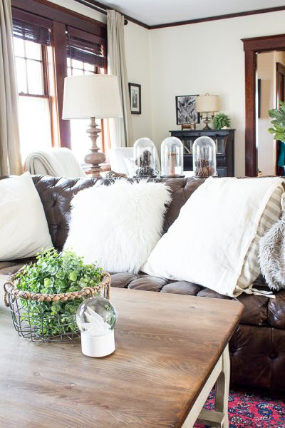 Cozy Winter Decorating - Varying Shades of White, Tufted Leather Sofa, Hints of Green - Finding Silver Pennies