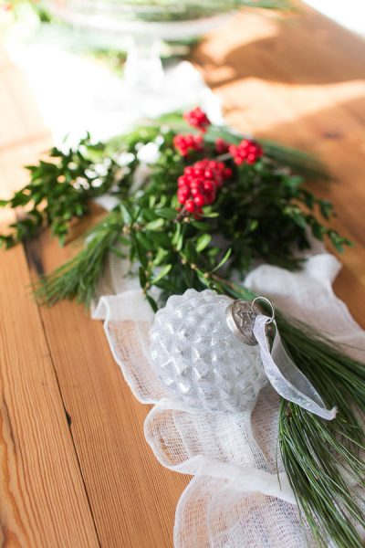 Strewn your table with pine, boxwood and holly to celebrate the season I Finding Silver Pennies