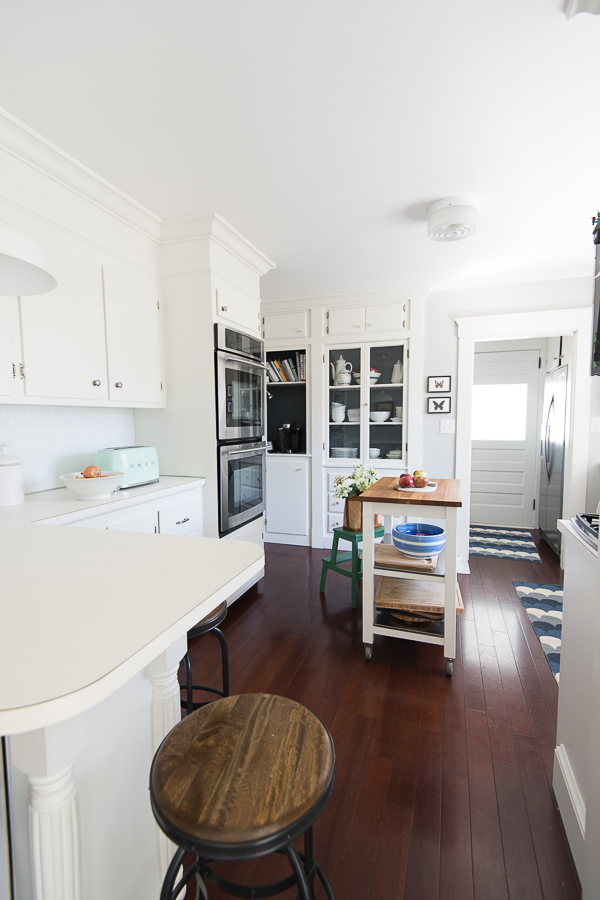 Bright White Cabinets and High Ceilings in this Coastal Kitchen - Finding Silver Pennies
