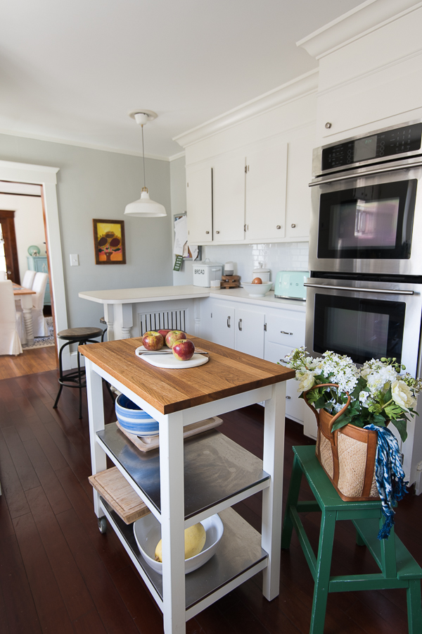 Bright white cabinets, gray walls and accents from Ikea created a timeless kitchen without renovating - Finding Silver Pennies