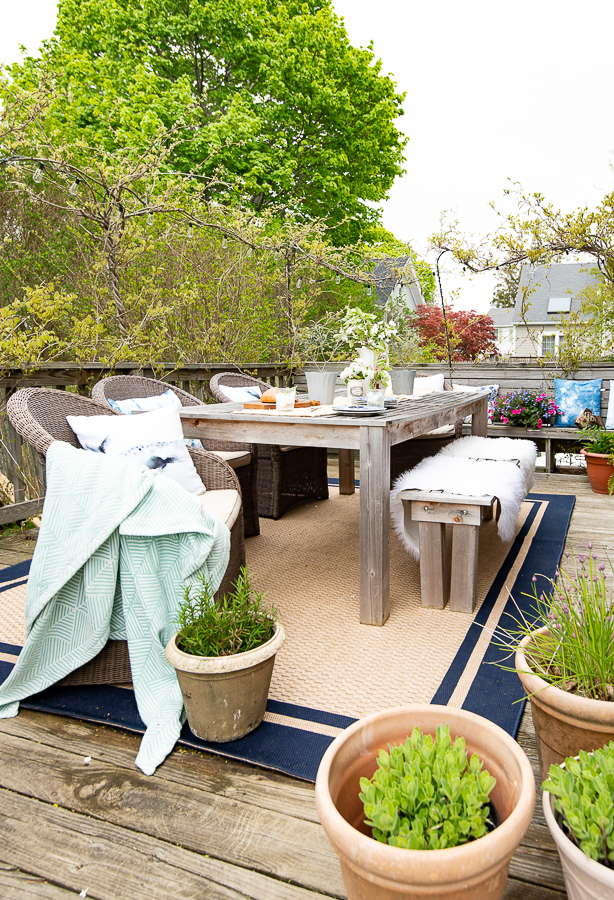 Make Your Deck Feel Welcoming with An Outdoor Rug - Finding Silver Pennies