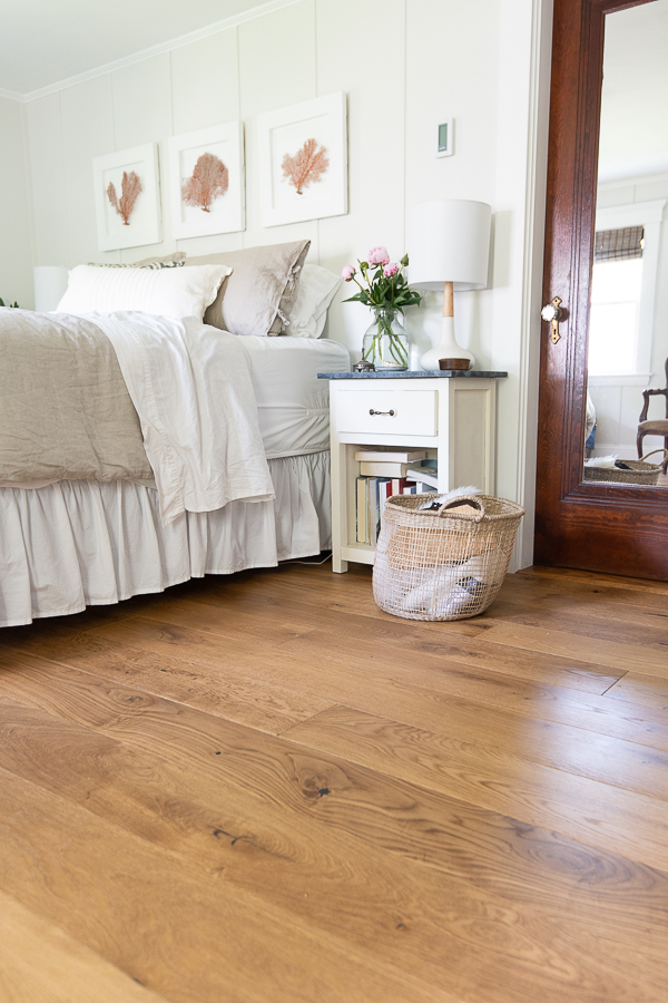Rich hardwood floors add warmth to a neutral bedroom - Finding Silver Pennies