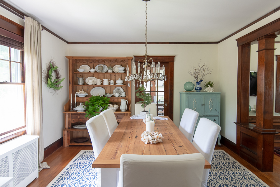 Blue and white rug grounds a very pretty coastal dining room - Finding Silver Pennies