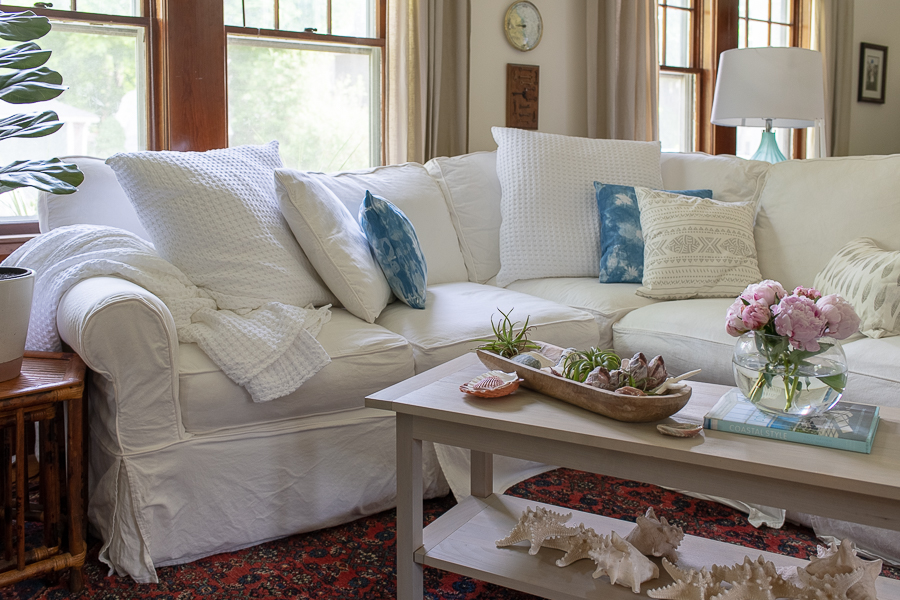 White Sectional and pretty coffee table are perfect for summer - Finding Silver Pennies