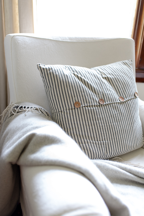 cozy spot for the paper, slipcovered chair, cashmere throw and ticking stripe pillow - Finding Silver Pennies