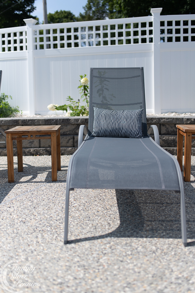 Comfortable loungers from Ikea complete this pool patio - Finding Silver Pennies